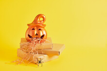 Ceramic Lamp And Paper Shavings For Gift Wrapping, Pumpkin Sick With Paper On Gifts,, Creative Halloween Concept