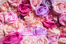 Floral Background With Colorful Artificial Roses. Flowers Pattern Background