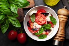 Caprese Salad With Fresh Tomatoes, Basil And Mozzarella Cheese