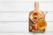 Leinwandbild Motiv Toast with fresh ripe figs and honey on light wooden background