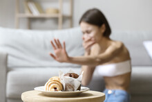 Young Woman With Anorexia Refusing From Food At Home