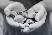 The Man Holds The Rubble In His Palms. A Handful Pieces Of Rando