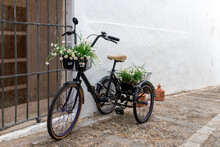 Tricycle Loaded With Flower Pots Decorating A Street In Vejer De La Frontera, A Nice Andalusian Town In The Province Of Cadiz, Spain