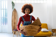 Happy Afro Woman Carrying Wickers Basket At Home