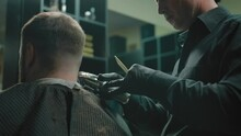Dark Dimly Lit Artistic Shot With A Trimmer Haircut In A Barbershop