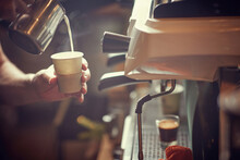 Close Up Of A Worker Making To Go Coffee