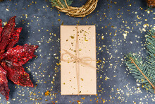 Winter, New Year's Composition. Box, Gift, Pine Cone, Flowers, Wreath On A Gray Background. View From Above.