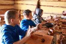 Three Boys Make Clay Crafts