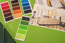 On A Green Background Laid Out Colored Palettes, Samples And Drawings Of The House With A Pencil