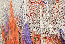 A Close-up Of Colorful Fishing Nets On A Boat