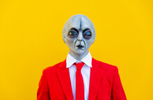 Portrait Of Man Wearing Alien Costume And Bright Red Suit