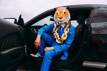 Funny Character In Animal Mask And Blue Business Suit Sitting In Car