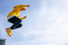 Boy Jumping On Sunny Day