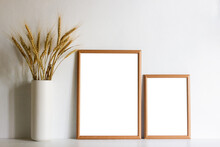 Two Wooden Frames With Organic Wheat In A Vase With Nature Light.