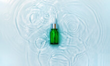 Cosmetics In A Bottle In Water, Skin Hydration Concept. Hyaluronic Acid. Selective Focus.