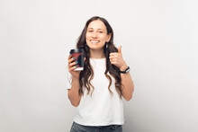 Young Smiling Woman Is Giving A Like To The Coffee She Has Just Drunk.