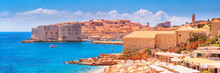 Coastal Summer Landscape, Panorama - View Of The City Beach On The Background Of The Old Town Of Dubrovnik On The Adriatic Coast Of Croatia