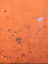 Orange Texture Old Wall With Peeling Paint, Scratches And Cracks