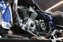 Motorcycle Engine On Stand In Car Workshop Closeup