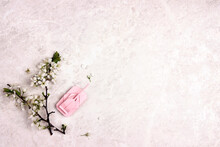 Pink Paper Origami Tank With Apple Blossom Branche On Light Marble Background.
