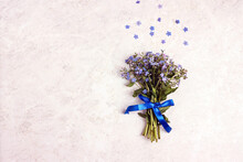 Small Bouquet Of Forget-me-nots On A Light Marble Background.