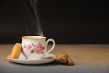 HOT  Cup Of Tea Served In A Traditional Mud Cup, Served In Cup And Saucer Closeup With Fumes Coming Out Of It With Selective Focus And Blur