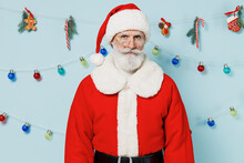 Old Serious Bearded Santa Claus Man 50s Wears Christmas Hat Red Suit Clothes Posing Look Camera Isolated On Plain Blue Background Studio Happy New Year 2022 Celebration Merry Ho X-mas Holiday Concept