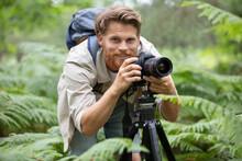 Professional Nature Photographer Using A Tripod