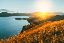 Stunning Mountain Landscape In The Sunset Rays Of The Sea Coast And Mountains In The Crimea. Panoramic View Of Koktebel And Cape Chameleon