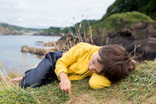 Children, Enjoying Quiet Cloudy Day On The Ocean Shore On The Cliff, Rocky Beach