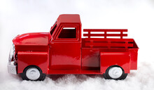 Red Pickup Truck In The Snow