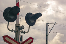 Traffic Light At A Railway Crossing. The Object Of Increased Attention Is At The Intersection Of The Road And Railways.
