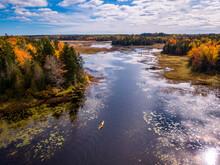 Kayaking During Fall Foliage In Maine