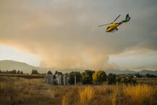 Emergency. Helicopter Flying To Forest Fire Sixth Generation Fire.
