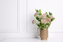 Stylish Ceramic Vase With Beautiful Flowers On Table Near White Wall. Space For Text