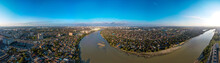A Large Aerial Panorama Of The Shallow Kuban River Near The Yubileiny Microdistrict Of The City Of Krasnodar And The Village Of Novaya Adygea (South Of Russia) On A Sunny Day In Mid-autumn.