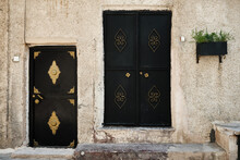 Entrance Doors Of Traditional Middle Eastern Stone House. Metal Doors Decorated With Copper Colored Wrought Metal On A Street Of Middle Eastern City. Streets Of Mardin, Turkey