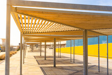 Close-up Of Huts With Wooden Roofs To Provide Shade In Front Of The Port Of The Forum In Barcelona