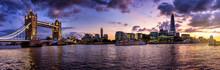Wide Panoramic View Of The Illuminated Skyline Of London During Colorful Autumn Dusk From The Tower Bridge Along The Thames River To London Bridge
