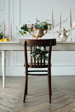 Close-up Of Vintage Wooden Wedding Chair And Festive Table Decoration For Gathering, Wedding, Party, Dinner With A Floral Bouquet, Candles.