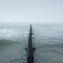 Baltic Sea In A Thick White Fog. An Old Pier (jetty). Waves, Splashing Water, Storm. Natural Textures. Picturesque Panoramic Monochrome Scenery, Seascape. Nature, Environment, Rough Weather, Danger