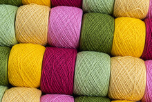 Knitting Needles, Colorful Threads. Knitting Pattern Of Colorful Yarn Wool On Shopfront. Knitting Background. Knitting Yarn For Handmade Winter Clothes. Colorful Background With Yarn Ball.