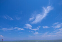 The Blue Sky Had White Clouds Scattered All Around.