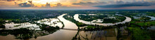 Panorama Top View Aerial Photo From Flying Drone.Flooded Rice Paddies And Village.Flooding The Fields With Water In Which Rice Sown. View From Above,chi River,Ubon Ratchathani Province,Thailand,ASIA.