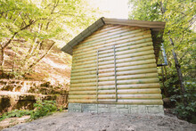 Wooden House In Nature Park For Hikers Recreation. Ecological Camping With Comfort