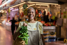 Portrait Of Happy Woman Buying Groceries In A Market Hall
