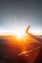 Finland, Wing Of Airplane Flying Against Rising Sun