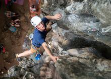Thailand, Krabi, Railay Beach, Man Climbing In Rock Wall