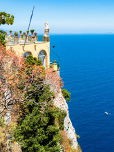 Italy, Campania, Capri, Gulf Of Naples, View To Restaurant And Terrace With Statue