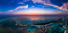 Maldives, Olhuveli Island, Aerial View Of Resort On South Male Atoll Lagoon At Sunset